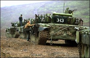 Russian tanks take position near the town of Bamut in the province of Chechnya in 199 during the second Chechen war.