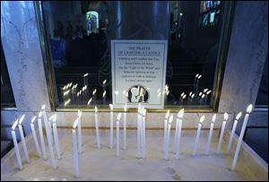 Candle lighting for prayer at Holy Trinity Greek Orthodox Cathedral.