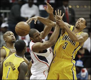 Atlanta Hawks center Al Horford (15) loses the ball as Indiana Pacers point guard George Hill (3) and Indiana Pacers shooting guard Lance Stephenson (1) defend.