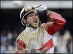 Joel Rosario celebrates after riding Orb to the winner's circle on Saturday in the 139th Kentucky Derby.