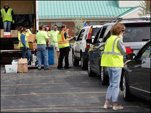 Cars line up for drop off during the recycling day.