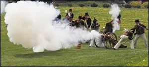 Re-enactors fire cannons to mark the First Siege of Fort Meigs that occurred on May 1, 1813. The celebration that concludes today is anchored at Fort Meigs but activities go on across the river.