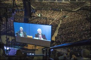 Tens of thousands attend Berkshire Hathaway shareholder meeting to hear Warren Buffett and Charlie Munger answer questions for more than six hours. No other annual meeting can rival Berkshire's, which is known for its size, the straight talk Buffett and Munger offer and the sales records shareholders set while buying Berkshire products.