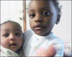Less than a year ago, Keondra Hooks, 1, left, was killed and her sister Leondra Hooks, 2, right, was seriously wounded in a shooting at the Moody Manor apartment complex.