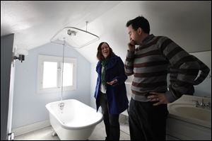 Christian Bell and his wife Beth Heinen Bell view a home for sale in Grand Rapids, Mich.