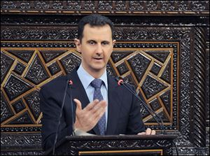 Syrian President Bashar Assad delivers a speech at the parliament in Damascus, Syria.