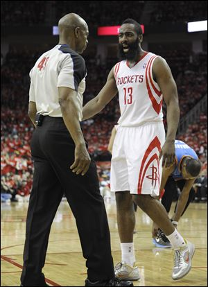 Houston Rockets' James Harden has words with referee Tom Washington in the second quarter.