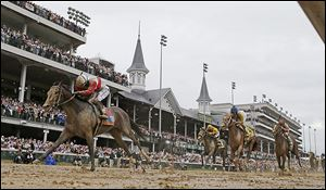 Joel Rosario rides Orb to victory during the 139th Kentucky Derby at Churchill Downs.