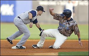 Toledo's Jordan Lennerton is caught trying to steal second by Charlotte's Steve Tolleson in the second inning at Fifth Third Field. The Mud Hens wore uniforms inspired by 'Star Wars.'