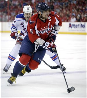 New York Rangers center Brian Boyle, left, chases Washington Capitals left wing Alex Ovechkin.