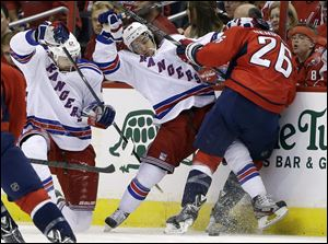 New York Rangers left wing Rick Nash, left, right wing Mats Zuccarello, center, a