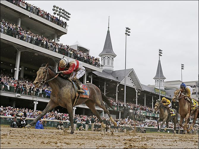 Joel Rosario riding Orb to win Joel Rosario rides Orb to victory during the 139th Kentucky Derby at Churchill Downs.