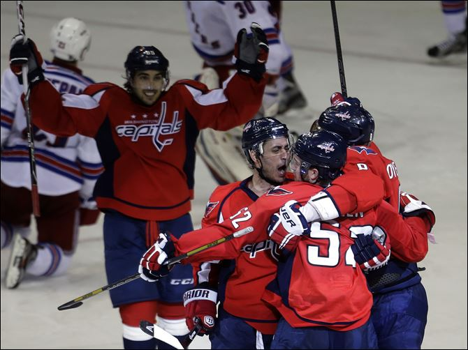 APTOPIX Rangers Capitals Hockey jubilation Washington Capitals defenseman Mike Green, second from right, is congratulated by teammates after he scored the game-winning goal in overtime.