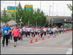 Thousands run and walk in a 5K on Saturday in front of the Cincinnati Bengals stadium as part of weekend-long events of the Flying Pig Marathon, now in its 15th year. A 5K and 10K on Saturday were sold-out, as were a half and full marathon set for today, with more than 33,000 participants expected overall.