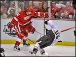 Detroit's Justin Abdelkader checks Anaheim's Toni Lydman during the second period of Game 3. The league ruled the hit deserved a two-game suspension. The Wings are down 2-1 in the series.