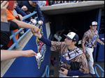 Mud Hens player Nick Castellanos (23) signs autographs before the Hens play the Charlotte Knights at Fifth Third Field, Saturday. The Mud Hens play again today at 2 p.m.