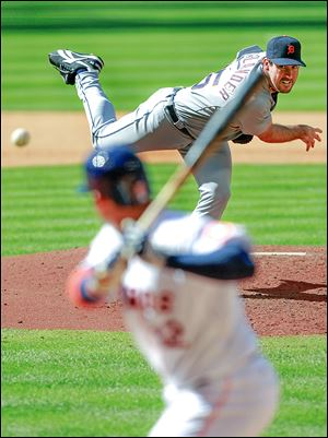 Detroit Tigers starting pitcher Justin Verlander delivers to the Astros' Carlos Pena in the fourth inning. Pena ended Verlander's bid for a third career no-hitter with a single in the seventh inning.
