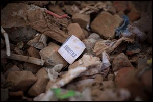 A clothes tag lies in the rubble of a garments factory that collapsed in Savar near Dhaka, Bangladesh.