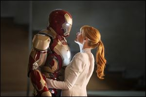Gwyneth Paltrow as Pepper Potts with Iron Man in a scene from