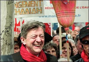 Jean Luc Melenchon, French leftist party chief, beams as protesters rally against the austerity measures announced by the French government, viewed as a broken campaign promise by President Francois Hollande.