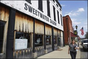 The Sweetwater Saloon dominates main street, taking up most of the block in Golconda, Ill. John Towns, owner of the Sweetwater Saloon says oil drilling would not bother him a bit.