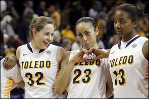 Flanked by UT teammates Ana Capotosto, left, and Mariah Carson, Inma Zanoguera shows a heart to her Spanish Club fans during a March game at Savage Arena. The Spaniard will enter her junior season among the top players in the league.