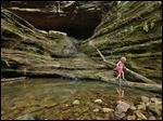 "Lucy Childers, 6, plays on the rock formations at Ferne Clyffe State Park in Goreville, Ill. Southern Illinoisans have hopes and fears surrounding the high-volume oil and gas drilling that may be starting in the Shawnee National Forest. Many people are beginning to brace for change as state lawmakers consider regulations that would allow energy companies to begin drilling deep in the southern Illinois bedrock for oil and natural gas, using a process known as high-volume hydraulic fracturing, or ""fracking,"" that has transformed the landscape in places like North Dakota and Pennsylvania."