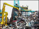 Trademark Metals Recycling yard in south Orlando, Florida has a machine that can pulverize an entire car in seven seconds.