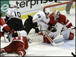 Anaheim Ducks left wing Matt Beleskey (39) trips over Detroit Red Wings right wing Daniel Cleary (11) as Detroit Red Wings goalie Jimmy Howard (35) defends in overtime of Game 4 of a first-round NHL hockey Stanley Cup playoff series in Detroit.
