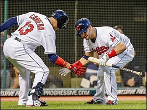 Cleveland's Nick Swisher greets Asdrubal Cabrera after Cabrera's solo home run in the fifth inning. He smacked two on the night.