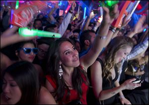 Revelers dance to the music played by DJ Cedric Gervais at the Surrender nightclub in Las Vegas.