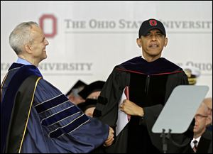 David Horn congratulates President Obama after he accepts an honorary doctor of laws degree at Ohio State's graduation ceremony at Ohio Stadium. Mr. Obama is the third sitting president to give Ohio State's commencement address, following George W. Bush in 2002 and Gerald Ford in 1974.