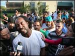 Neighbor Charles Ramsey speaks to media Monday about his experience helping the women escape.