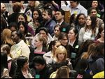 A crowd of job seekers attends a healthcare job fair, in New York in March.