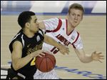 Wichita State's Fred Van Vleet (23) moves the ball as Louisville's Tim Henderson (15) defends during a the NCAA Final Four tournament semifinal game, April 6 in Atlanta. Louisville went on to defeat Michigan in the championship game.