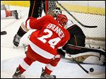 Damien Brunner's game-winning goal past Anaheim goalie Jonas Hiller gave the Red Wings a 3-2 overtime win, plus momentum going into Game 5 today. The best-of-seven series is tied 2-2.