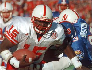 In this 1995, file photo, Nebraska quarterback Tommie Frazier runs to inside the one-yard line during of a game in Lawrence, Kan. Frazier was selected today to the College Football Hall of Fame.