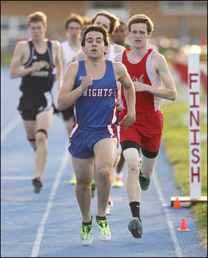 Kyle Lach of St. Francis leads the 1600-meter race at the Knight Relays. The senior, who qualified to state last year in the event, will run cross country at the University of Dayton.