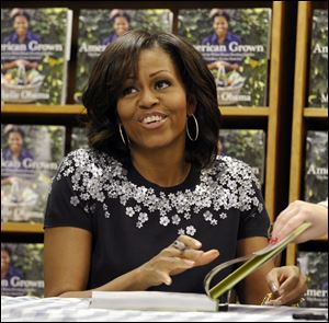 First lady Michelle Obama signs copies of her book