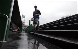 Detroit Tigers pitcher Doug Fister  heads to the clubhouse after an interleague baseball game against the Washington Nationals was rained out today at Nationals Park in Washington. They have rescheduled the game for Thursday.