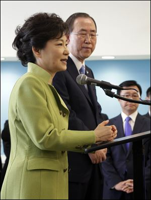 South Korean President Park Geun-hye, left, accomapnied by UN Secretary General Ban Ki-moon, addresses South Korean nationals at United Nations headquarters,  Monday.