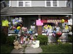 The front porch of Amanda Berry's home is decorated with balloons and signs in Cleveland.
