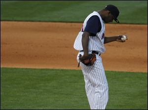 Mud Hens pitcher Ramon Garcia takes a moment as he gets ready to deliver a pitch.