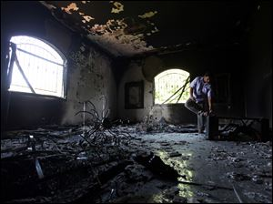 A Libyan man investigates the inside of the U.S. Consulate on Sept. 13, 2012, after an attack that killed four Americans, including Ambassador Chris Stevens.