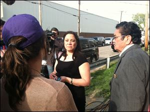 First cousin of the three suspects Maria Castro-Montes, center, speaks to the media on Cleveland's Seymour Avenue early today.