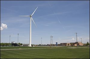 Archbold School District's wind turbine, next to the high school football field, was dedicated Wednesday afternoon with a ceremony and ribbon cutting.