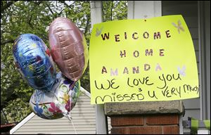 A sign on the porch greets Amanda Berry after her release from captivity. Ms. Berry was taken into her sister's home through a back door, out of sight from reporters and onlookers.