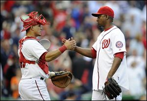 Washington Nationals relief pitcher Rafael Soriano celebrates a 5-4 win with catcher Wilson Ramos.