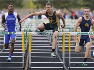 Oregon Clay runner Jack Nagy clears the final hurdle ahead of Anthony Wayne's Jamar Allen, left, and Whitmer High Schools Nate Holley, right, to win the 110 meter hurdles.