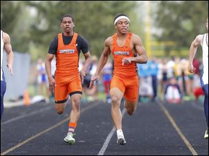 Sylvania Southview sprinter Malcolm Johnson, second from right, checks the competition as he wins the 100 meter dash ahead teammate Jeremy Cook, and Liberty Benton runners Kyle Bowsher, left, and Chase Cook, right.